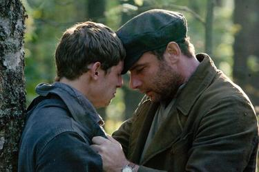 "Jamie Bell as Asael Bielski and Liev Schreiber as Zus Bielski in ""Defiance."""